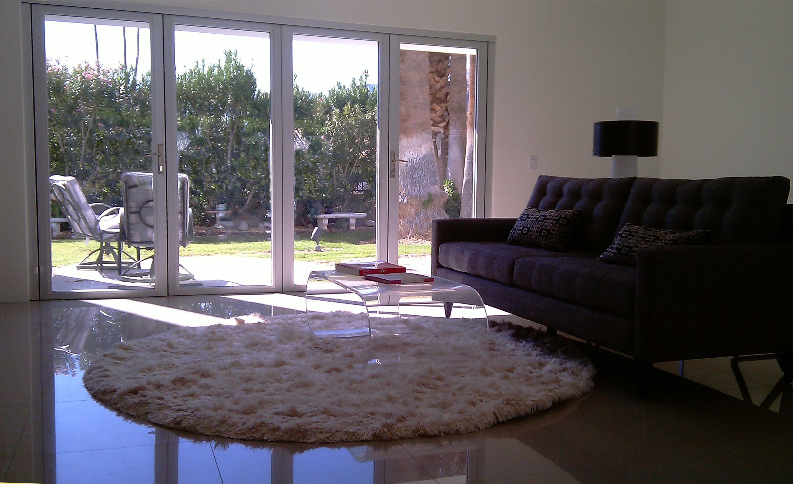 living room with white aluminum bifold doors